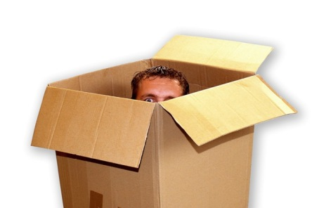 man-peeking-out-of-moving-box.jpg w=640